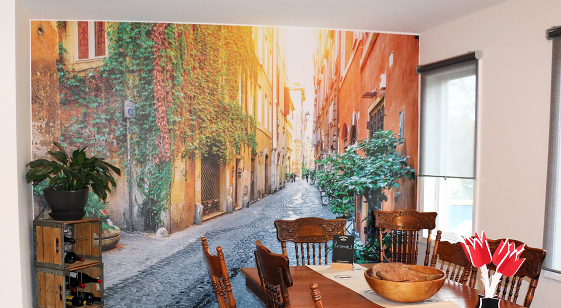 Image of a vinyl wall covering depicting a street scene in a dining room area.