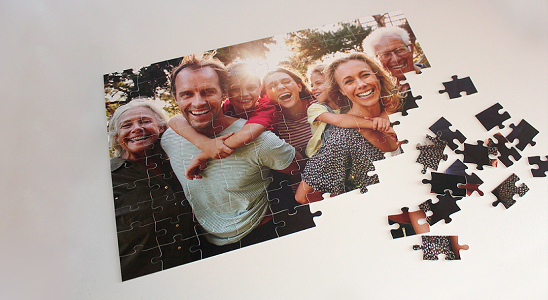 Image of a custom puzzle depicting a smiling family photograph.