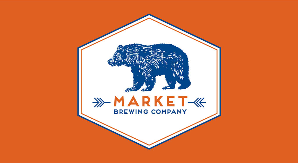 The Market Brewing Company logo with a large navy blue bear is displayed on a solid orange background.