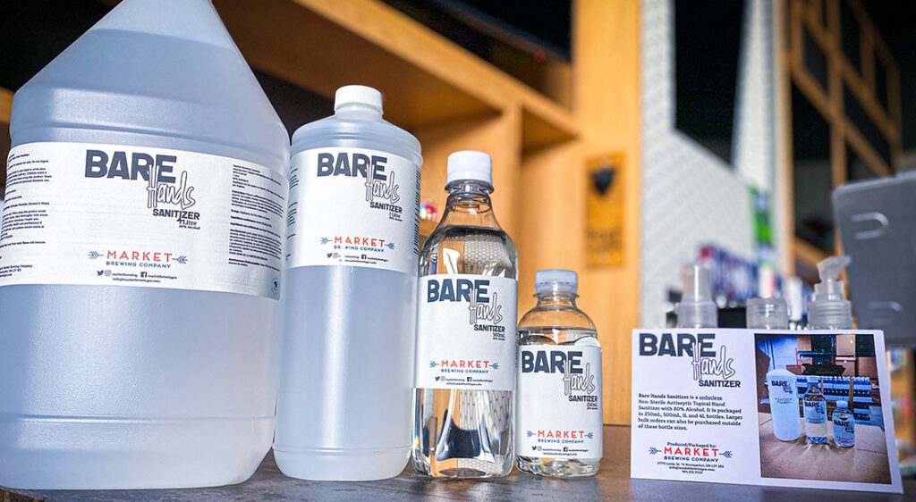 Bare Hands Sanitizer products in each available size are lined up beside a promotional postcard for the sanitizer line.